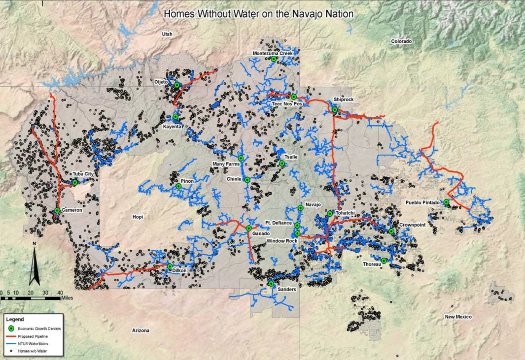 This map, provided by the Navajo Tribal Utility Authority, shows areas on the Navajo Nation where homes don't have water (black dots), existing water systems (blue lines) and proposed water pipelines (red lines).