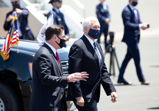 Vice President Mike Pence arrives for a meeting with Gov. Doug Ducey at Sky Harbor International Airport in Phoenix on July 1, 2020. Pence is leading the White House Coronavirus Task Force and is visiting Arizona, one of the new coronavirus hotspots in United States.