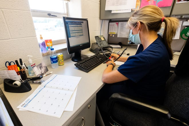 Public Health Nurse Meg Cary works on COVID-19 contact tracing Wednesday, July 1, 2020, at the St. Clair County Community Health Department in Port Huron.