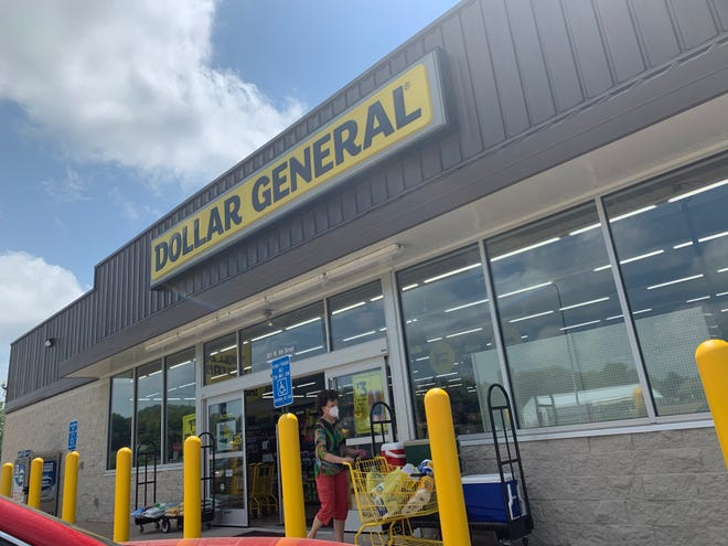 Customers shop at the Dollar General store in Dell Rapids on Tuesday, June 30, 2020.