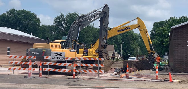 Road crews work in Brandon on the corner of Main Avenue and Dogwood Street on Tuesday, June 30.