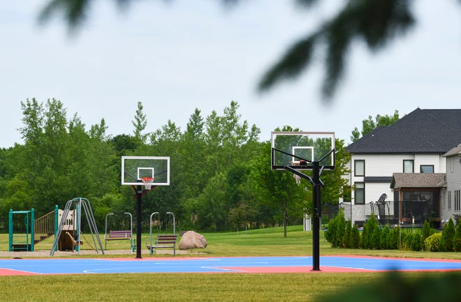 The existing basketball court at The Wilds park is pictured Wednesday, July 1, 2020, in Sartell.