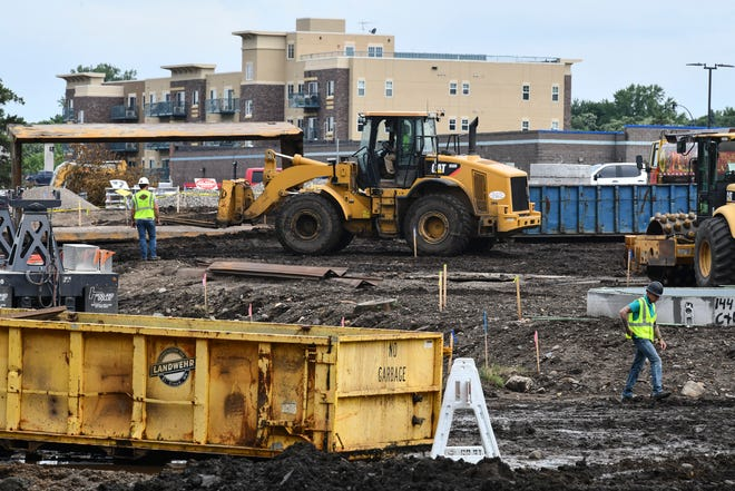 Construction crews work on a portion of the Southside and Lions Park project Wednesday, July 1, 2020, in Sauk Rapids.