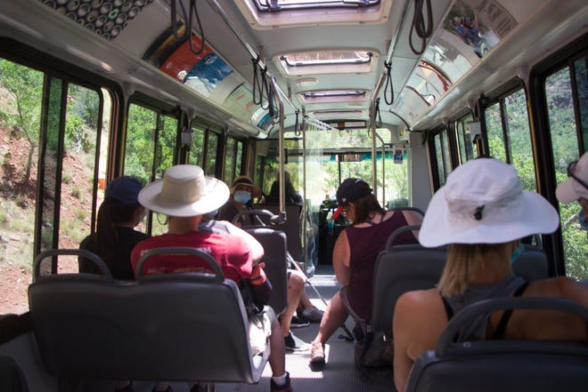The shuttles through Zion National Park canyon reopened July 1, 2020 to thousands of visitors amid the coronavirus pandemic.