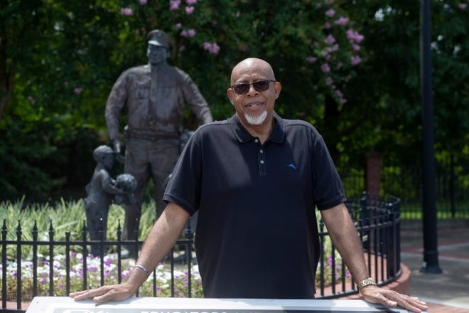 Fred Lee Jr. stands in front of the statue of his father, Tallahassee's first Black police officer, which resides at the corner of Macomb and Georgia streets, Tuesday, June 30, 2020.