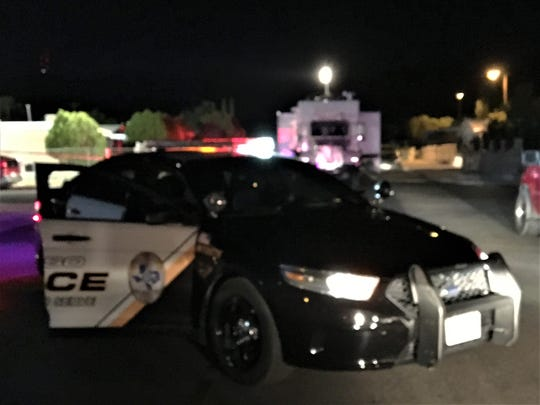 An El Paso police car and the police mobile command vehicle sit on Fillmore Avenue during an investigation into a fatal shooting on Tuesday night, June 30, 2020.