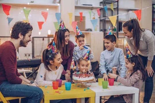 Children celebrating a birthday together