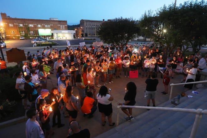 Seajay Dyer speaks about being victim of a hate crime during a Pride event in front of the Muskingum County Courthouse in Zanesville on Tuesday.  Approximately 150 people took part in the Pride Candlelight March starting at Zane's Landing Park and winding through downtown Zanesville before gathering at the courthouse.