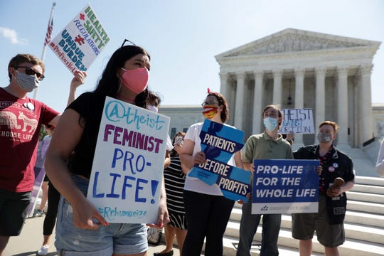 WASHINGTON, DC - JUNE 29:  Pro-life activists participate in a demonstration in front of the U.S. Supreme Court June 29, 2020 in Washington, DC. The Supreme Court has ruled today, in a 5-4 decision, a Louisiana law that required abortion doctors need admitting privileges to nearby hospitals unconstitutional.  (Photo by Alex Wong/Getty Images) ORG XMIT: 775527899 ORIG FILE ID: 1253281017