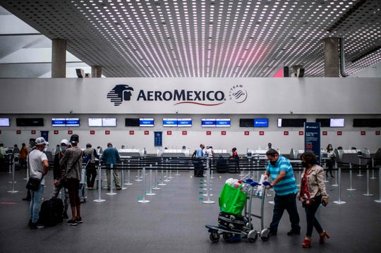 Passengers wait at the counters of Aeromexico at Mexico City's International Airport. Mexico's largest airline has filed for Chapter 11 reorganization to help it survive the effects of the coronavirus pandemic.