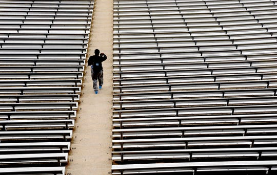 The crippling grip the coronavirus pandemic has had on the sports world has forced universities, leagues and franchises to evaluate how they might someday welcome back fans to stadiums such as North Carolina's Kenan Stadium.