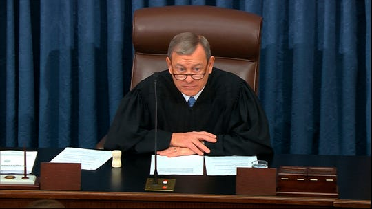 In this image from video, presiding officer Chief Justice John Roberts speaks during the impeachment trial against President Donald Trump in the Senate at the U.S. Capitol in Washington, Thursday, Jan. 23, 2020.