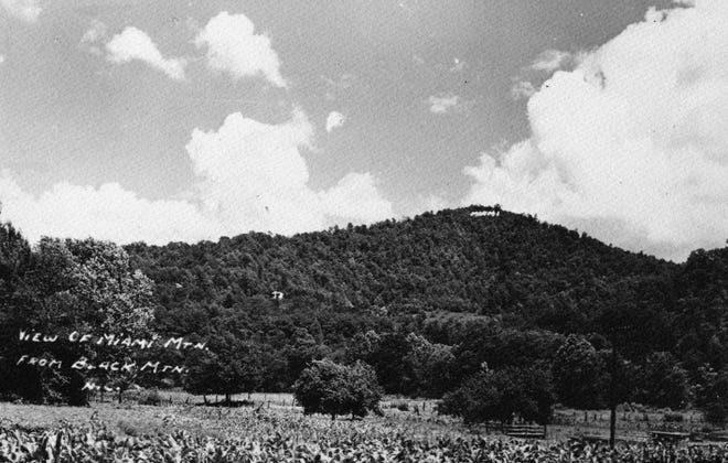 This photo shows a view of Miami Mountain from Black Mountain, circa late 1910s. During the first quarter of the 20th century, Miami Mountain was the home of the Sunset Park Hotel (also called the Peabody Hotel), one of Black Mountain's busiest tourist attractions.