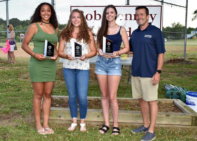 Riverside High School's Jaison-Ashley Pleva (left to right), Emily Schmitt and Amberlee Jack receive their awards from Ed Kenney.