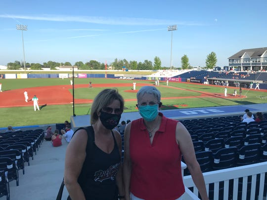 Rebecca Gearing Troy, left, and Susan Elben, of Lake Ann, pose for a picture before a game at Turtle Creek Stadium in Traverse City on Wednesday, July 1, 2020.