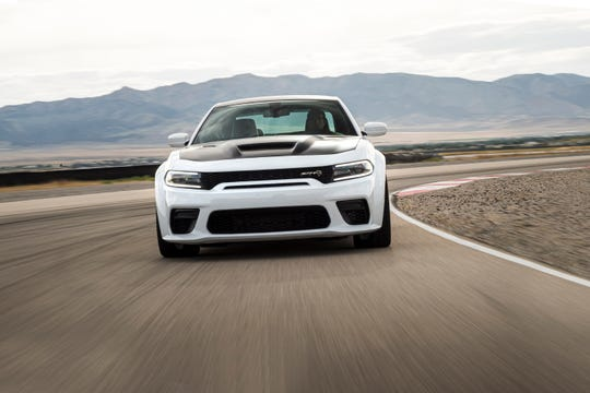 With 797 horsepower the 2021 Dodge Charger SRT Hellcat Redeye is the most powerful and fastest mass-produced sedan in the world and features a newly designed, functional performance hood.