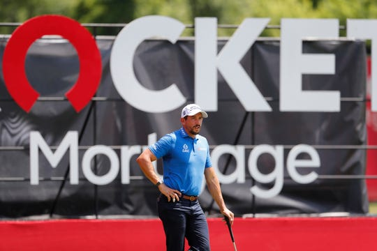 Scott Stallings waits to putt on the 18th green during the first round of the Rocket Mortgage Classic golf tournament, Thursday, July 2, 2020, at the Detroit Golf Club.