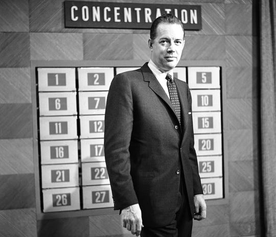 """This Feb. 15, 1960 file photo shows host Hugh Downs on the set of the game show """"Concentration"""" in National Broadcasting Company Studio in New York."""