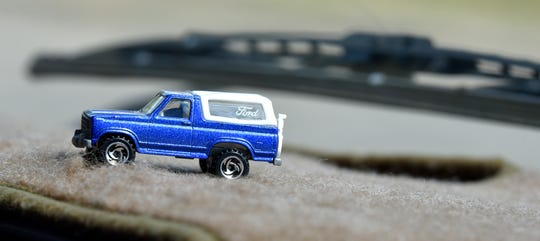 A toy Bronco on the carpeted dash of the full-size Bronco owned by Shanna Gibson.