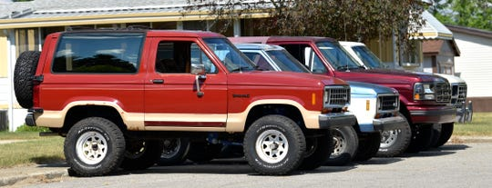 A 1986 Ford Bronco II, front, owned by Merry Parks, John Park's 20-year-old daughter, a 1987 Bronco II and 1996 full-size Bronco, both owned by John Parks ; and a 1985 full-size Bronco owned by John's fiance Shanna Gibson.