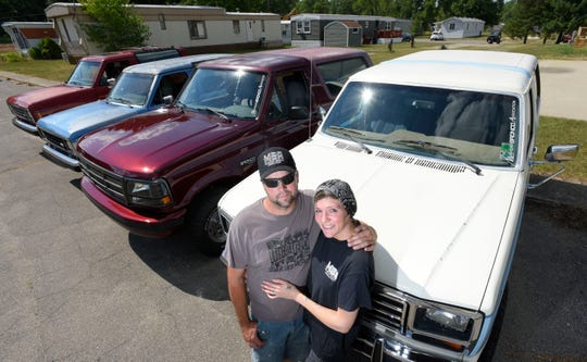 John Parks and his fiancee, Shanna Gibson, both of Highland Township, pose with their family's four Ford Broncos. The new Bronco will debut Monday. The new 2021 Ford Bronco is scheduled to be revealed, Monday, July 13.