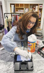 Aviva Susser cleaning the machine in her store.