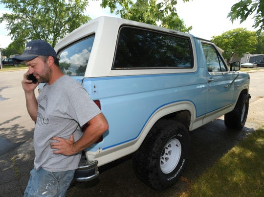 John Parks talks on the phone while standing near the rear of this 1985 Full-Size Bronco (FSB), owned by his fiancee, Shanna Gibson (not pictured).