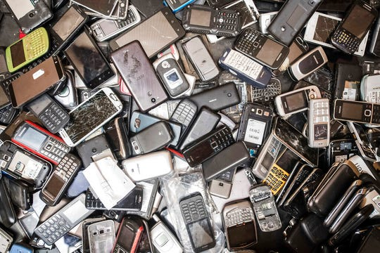 Old mobile phones fill a bin at the Out Of Use company warehouse in Beringen, Belgium. The world's mountain of discarded flat-screen TVs, cellphones and other electronic goods grew to a record high last year, according to an annual report released Thursday.