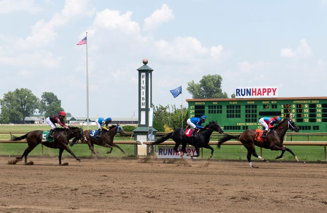 Horses cross the finish line during a 2020 race at Ellis Park.