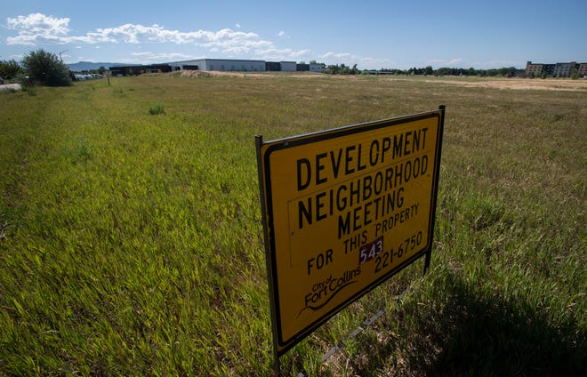 A sign announces a development neighborhood meeting for an empty lot in the Harmony Technology Park in Fort Collins, Colo. on Wednesday, July 1, 2020. The technology park is on the verge of great growth with nearly 250,000 square feet of new office, manufacturing and commercial space.