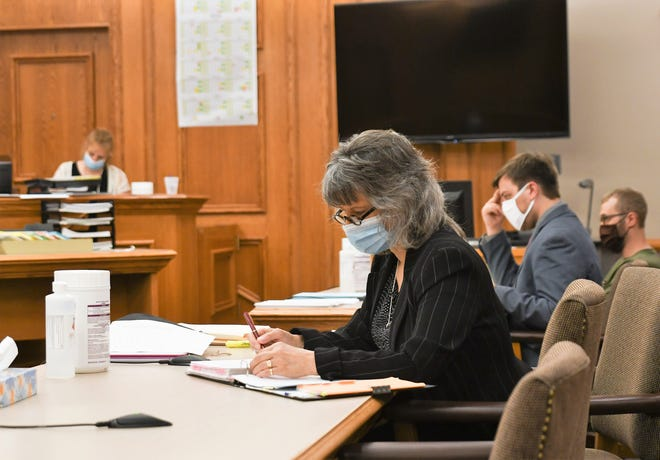 Oconto County Assistant District Attorney Lisa Rowe is seen at a hearing Thursday, July 2, in Oconto County Circuit Judge with defense attorney Evan York and his client. A member of the Clerk of Court's staff is at left.