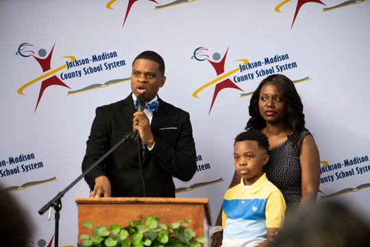 JMCSS Superintendent Dr. Marlon King speaks to the community of Jackson, with his family by his side, Director of Public Relations Latisha King and Hudson King, 12, on his first official day  during the welcoming event at the JMCSS Central Office in Jackson Tenn., Wednesday, July 1, 2020.
