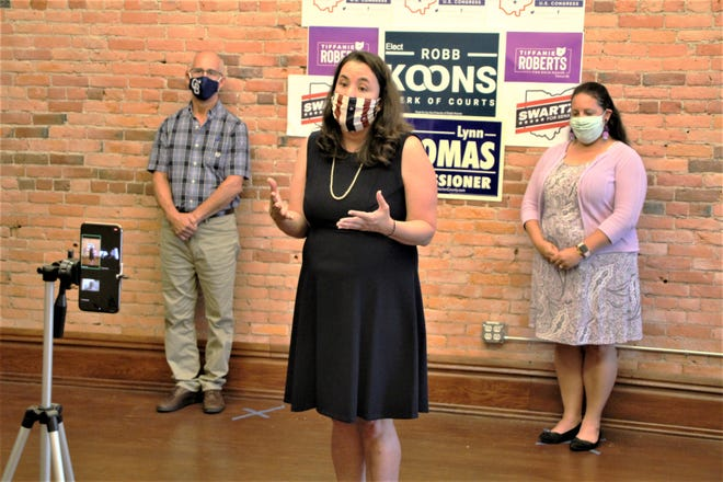 Congressional candidate Shannon Freshour, D-Marysville, speaks to members of the Marion County Democratic Party during a campaign kickoff event on Wednesday, July 1, 2020, in Marion. Freshour and two other candidates are seeking to unseat Rep. Jim Jordan, R-Urbana, in November's general election. Ohio Senate candidate Craig Swartz, left, and Ohio House candidate Tiffanie Roberts, right, also attended the kickoff event.