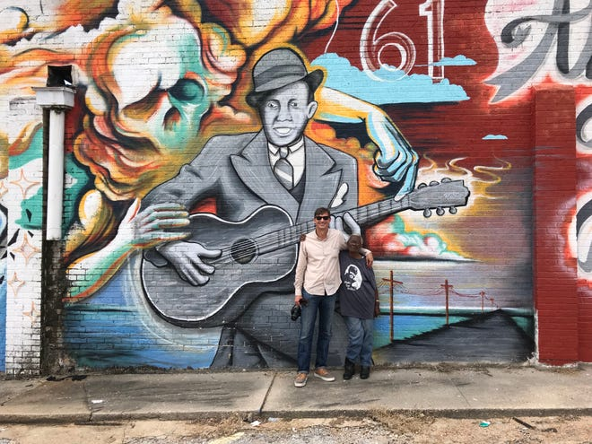 """Brother Robert"" author Annye C. Anderson, with co-author Preston Lauterbach, in front of a Robert Johnson mural in Memphis, 2019."