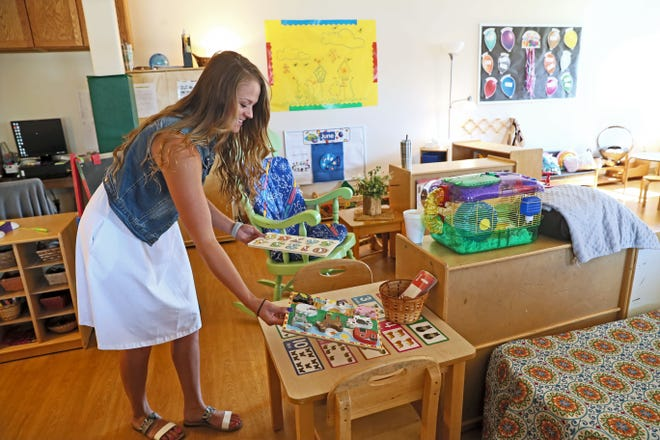 Alyssa Fonk, Pre-K lead teacher in the onsite child care program at the company, prepares a classroom for the children at Inpro, a maker of interior and exterior architectural products in Muskego.