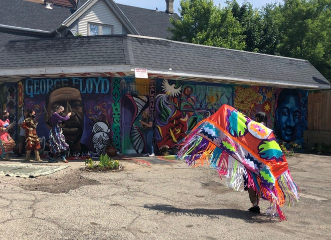 The jingle healing dance being performed before the George Floyd mural.