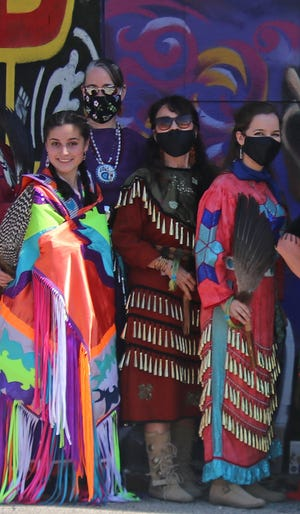 Margaret Noodin, Kimberly Blaeser and their daughters prepare to perform a Jingle Dress Dance for healing.