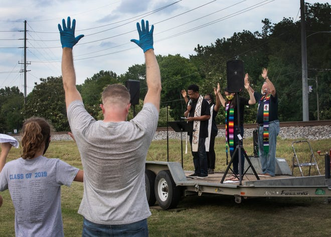 """The Rev. Stephen Handy speaks at """"A Prayer Service to Stand Against Racism"""" on June 5 at Belle Meade United Methodist Church. Handy read, """"We raise our hands and we remember Mike Brown, who said, 'Don't shoot.' """""""