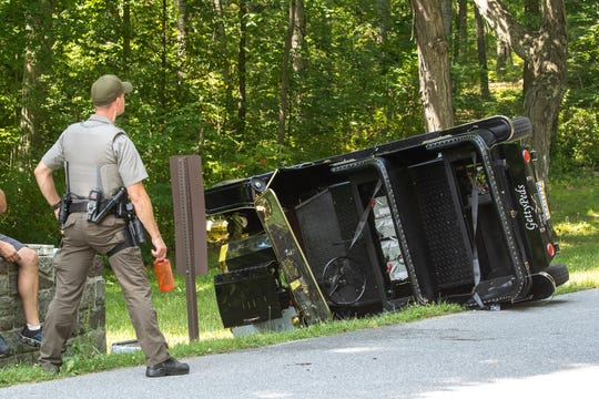 Police investigate at the scene of a single vehicle accident with entrapment involving a GettysPed tour vehicle on West Confederate Avenue, Thursday, July 2, 2020, in the Gettysburg National Military Park in Cumberland Township. According to Jason Martz, acting public affairs officer for Gettysburg National Military Park, two people were flown from the scene with life threatening injuries, and three were taken to the hospital by ground ambulance.