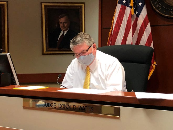 Manistee Justice Court Judge Donald Watts sits in his courtroom on June 30, 2020, at the Maricopa County Northwest Regional Court Center in Surprise. The Maricopa County Justice Courts are open during the COVID-19 pandemic with limited in-person proceedings.