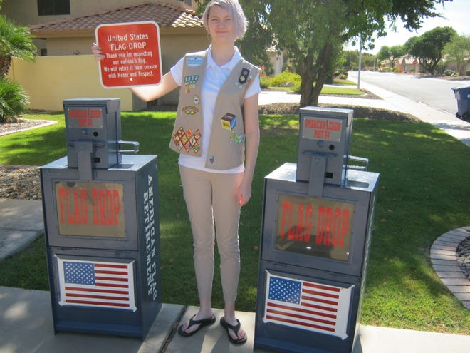 Senior Scout Jane Spellman stands next to finished flag depository boxes used for Gold Award project.