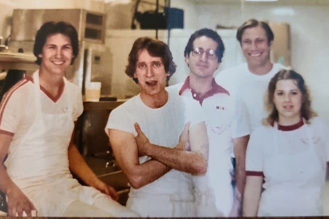 Rick Rosati poses with his arms crossed at a restaurant he opened in Texas in the 1980s.