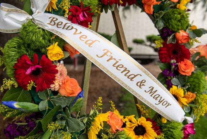 "A wreath with a sash that reads, ""Beloved Friend & Mayor"" is placed in the center of the memorial outside City Hall to honor the life of Salinas Mayor Joe Gunter, who passed away earlier this week. This photo was taken on Wednesday, July 1, 2020."
