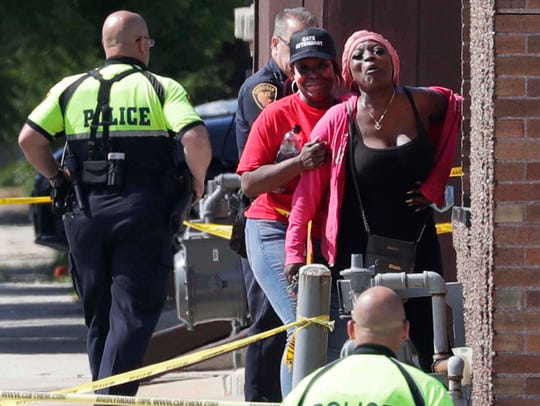 Relatives and friends of the Black man shot by police, react on the corner of N. 15th and Indiana Avenue by police lines, Thursday, July 2, 2020, in Sheboygan, WIs.