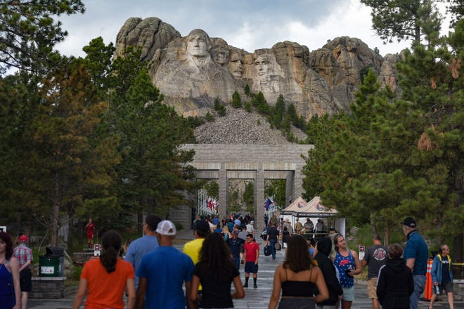 People visit Mount Rushmore on July 2, 2020, the day before it is closed for a presidential visit.