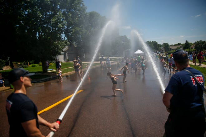 Sioux Falls firefighters spray kids with water during a Hydrant Block Party on Thursday, July 2, 2020 at Prairie Trail Park in Sioux Falls, S.D.