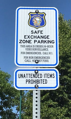 A street sign in the Sioux Falls Police Department's front parking lot marks a safe area for people to complete transactions under video surveillance.