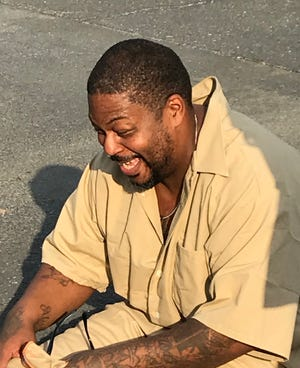 Rojai Fentress sits in disbelief in the parking lot of Augusta Correctional Center moments after being freed from prison after being incarcerated for 24 years. He was given a conditional pardon on July 1, 2020, by Gov. Ralph Northam.