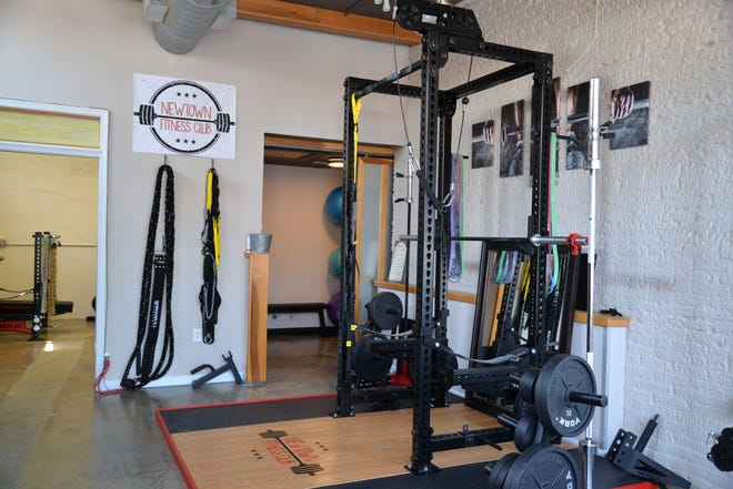 Ben Huson recently opened Newtown Fitness Club, a new contact-less gym that allows people to use a keyless entry fob to get in the space after the member reserves a spot.