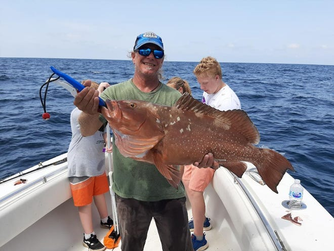 This 19.44lb red grouper caught while fishing with Captain Clint Taylor.